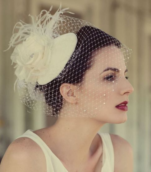 wedding-hats-with-birdcage-veil-feather-floral-accents__full